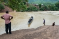 COPE Rehabilitation Manager, Suresh Selvaraj, waits for patients to make their way across a river to the mobile clinic